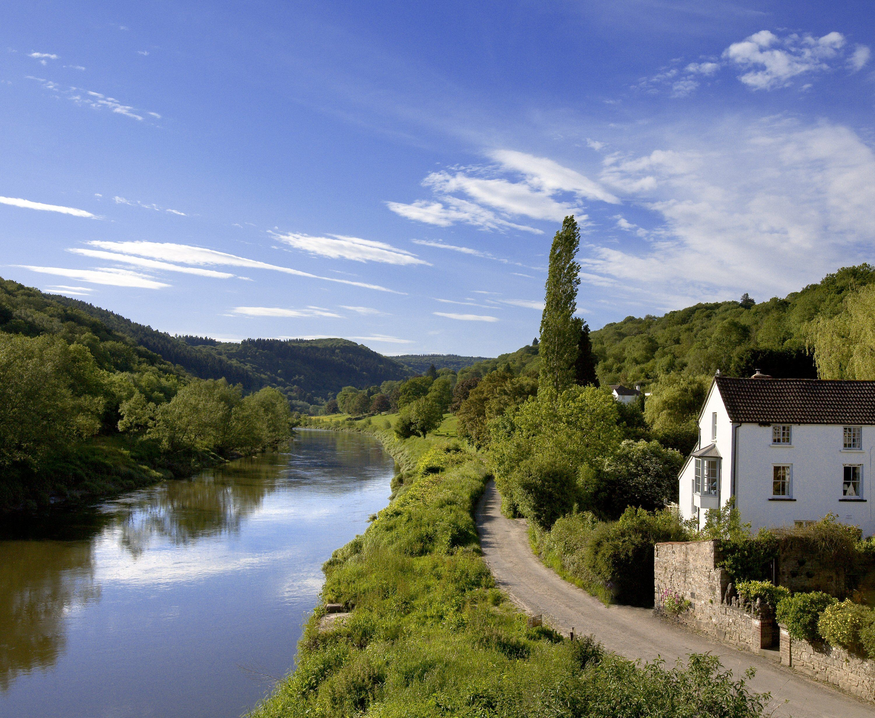 picturesque house by the river in countryside photography
