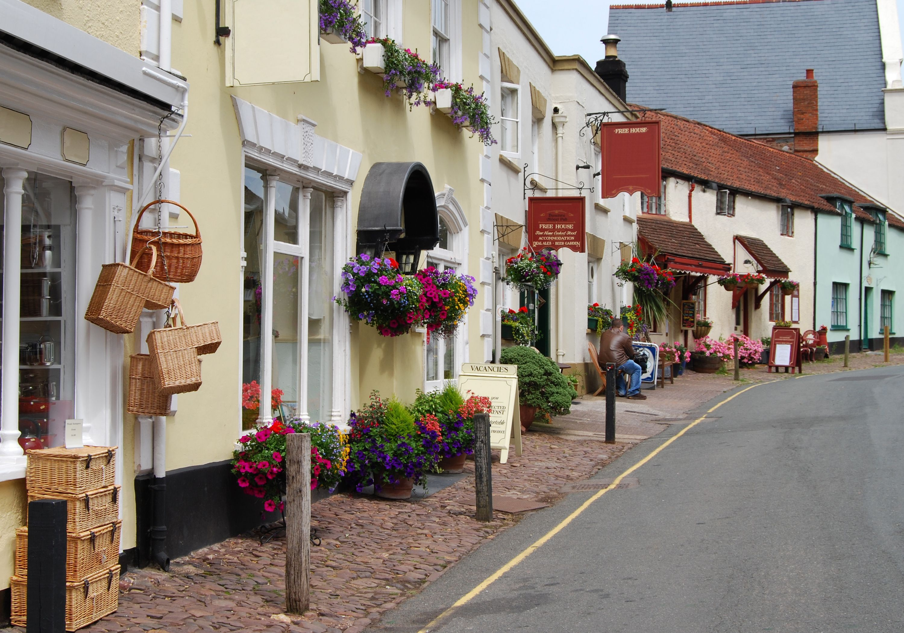pretty coastal village with colourful cottages and shops
