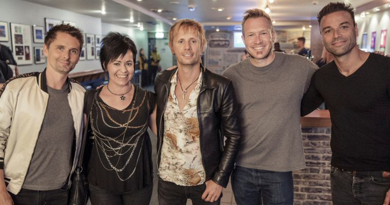 Who won the Muse tickets charity auction?