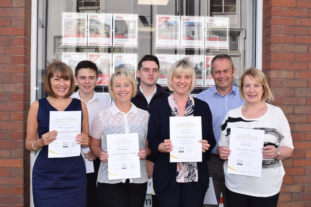 Top marks as 100 per cent of estate agent's staff pass professional training qualifications